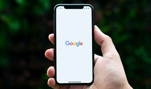 Person holding mobile open on Google
